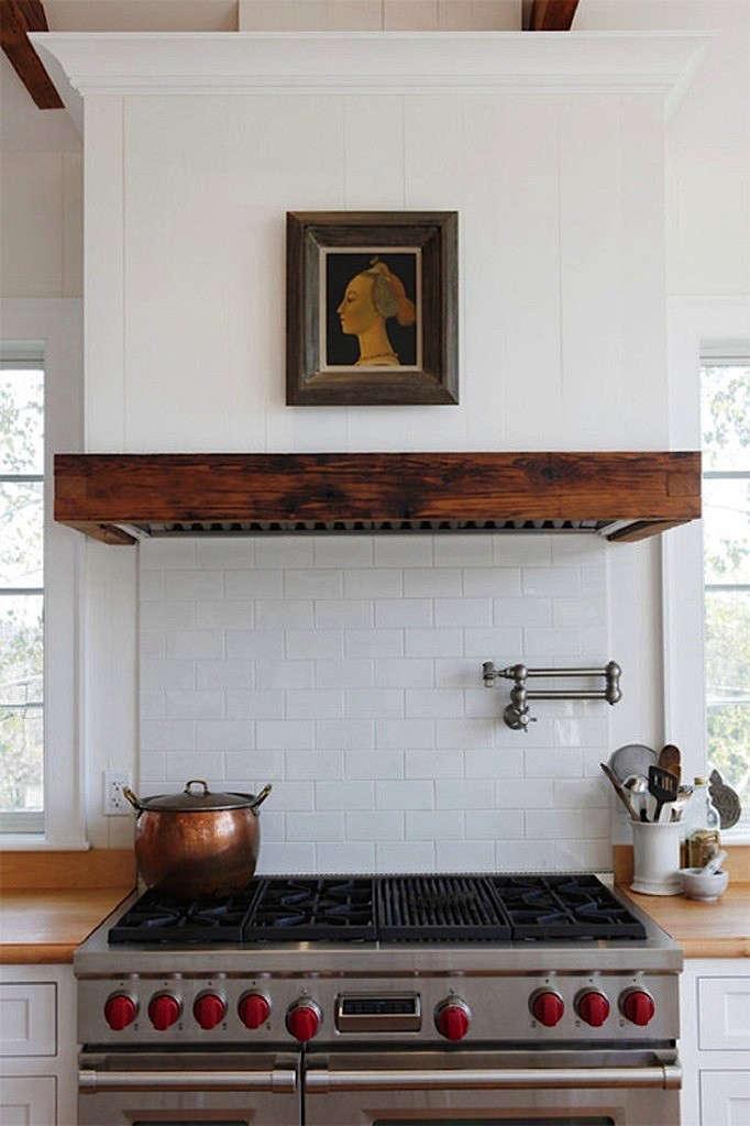 Wood Stove Hoods ~ Rustic wood clad vent hoods remodelista