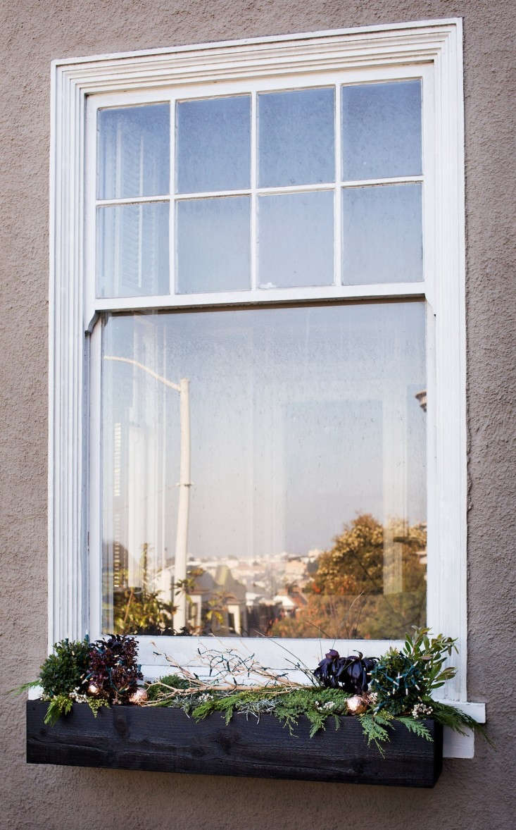 Holiday%20Window%20Box%20Painted%20Black%20with%20City%20Reflection%20in%20Window%2C%20Gardenista