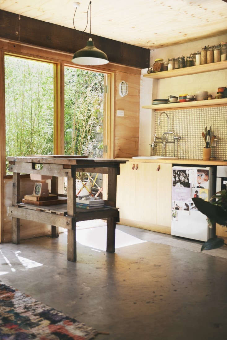 Melbourne, Australia-basedHearth Studioturned a garage into a small home complete with kitchen, dining area, bedroom, and bath (with green clawfoot tub). The designers managed to fit it all in while retaining the character of the garage, including its hardworking concrete floor.For more, seeOutbuilding of the Week: Garage Turned Studio Apartment. Photograph byLauren Bamford.