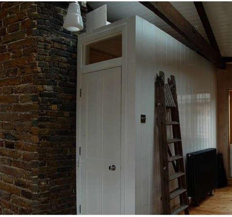 antoni-alison-brick-wall-white-door