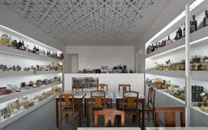 Fugas Lusas, Portuguese delicacies, cafe, white ceiling, laser cut pattern, food display along wall, strip lighting