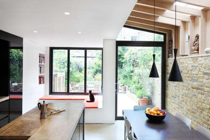 700_book-tower-house-with-eat-in-kitchen-and-modern-black-pendant-lights