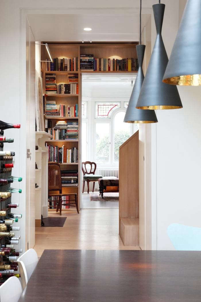 700_book-tower-house-with-pale-wood-bookshelf-and-black-pendant-lights