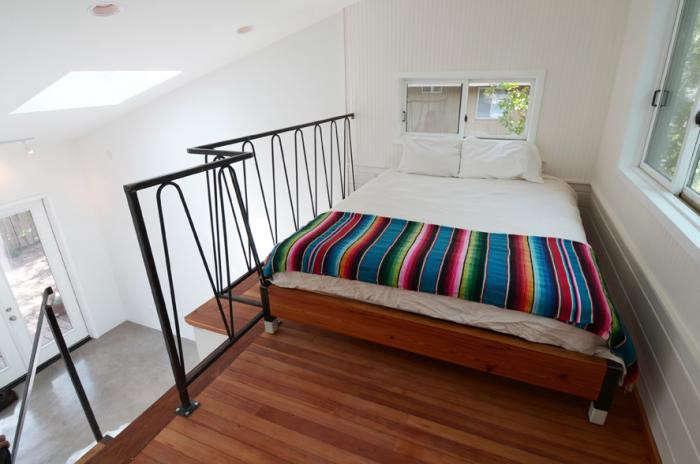 700_loft-bedroom-with-mexican-blanket-in-photography-studio-by-karwheel