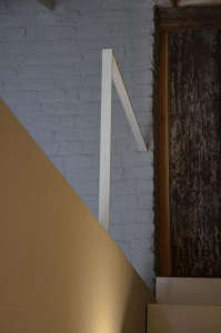 Modern white stair rail detail in bare apartment in Italy