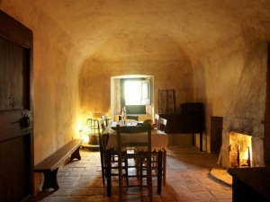 Dining room in medieval hotel in Italy with stone floors