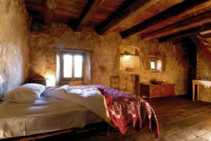 Romantic hotel in Italy with crochet bedspread and rustic wood