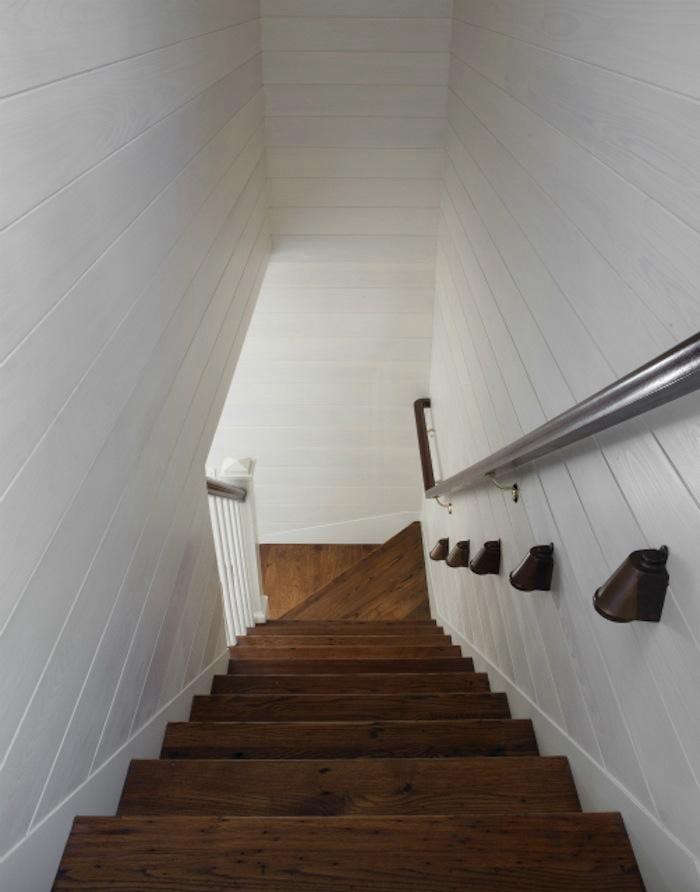 700_wettling-architects-shelter-island-worn-stair-with-white-painted-interior-siding
