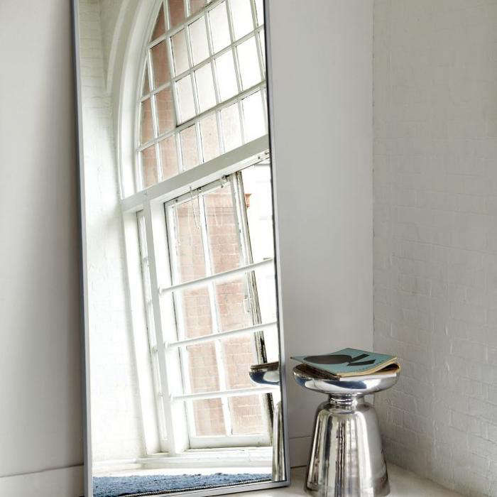 above the metal floor mirror with a brushed nickel frame leans against the wall 299 from west elm