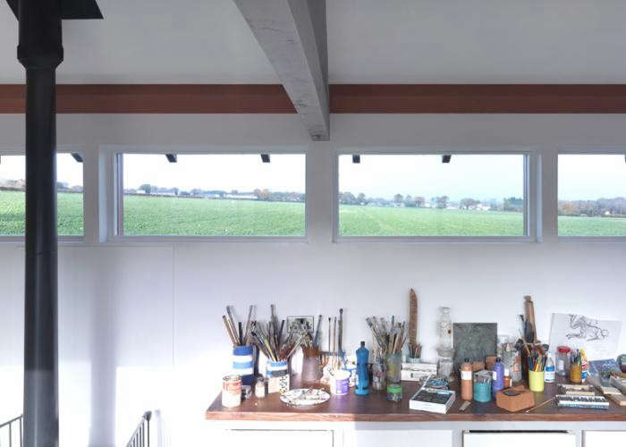 700_artists-studio-by-threefold-architects-with-art-materials-and-small-windows