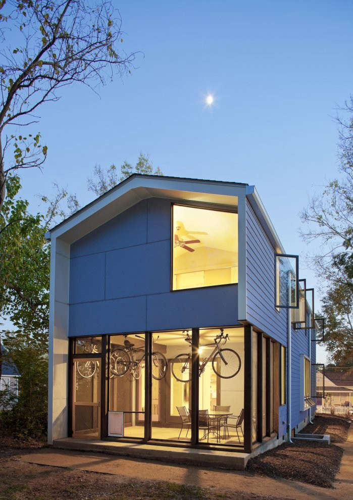 modern-house-at-night-by-in-situ-studio-with-blue-exterior-and-twilight-glow
