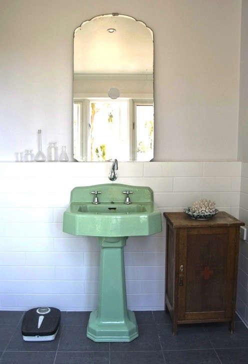green-sink-black-tile-floor