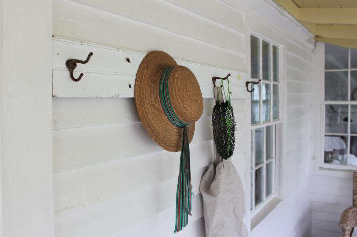 The finished product, made with a piece of salvaged board, holds beach items on my porch.