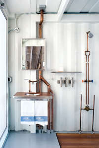 Jeff Wardell and Claudia Sagan's Bathroom with Copper Pipes from Dwell, Remodelista