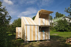Anna and Eugeni Bach, Wood Playhouse with Finnish construction, natural wood and white wood planks, Remodelista