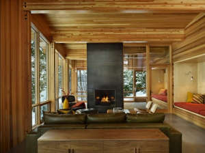 DeForest-Architects-Lake-Wenatchee-living-area-western-red-cedar-ceiling-wall-panels-glulam-beams-blackened-steel-fireplace-surround