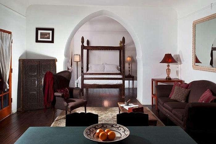 700_korakia-pensione-indoor-suite-dark-wood