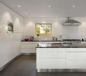 Platform-5-Meadowview-modern-house-white-kitchen-cabinets-black-counters-picture-window