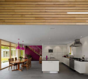 Platform-5-Meadowview-modern-house-white-kitchen-pink-walls-pink-pendants-wood-chairs-dining-table