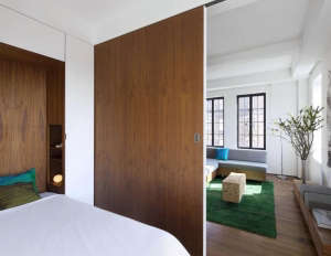 Transformer-Apartment-Studio-Garneau-wood-floors-white-walls-green-carpet-murphy-bed