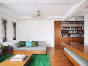 Transformer-Apartment-Studio-Garneau-wood-floors-white-walls-green-carpet