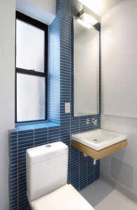 Uniform-Design-Minimalist-bathroom-style-blue-horizontal-tiles
