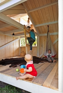 Anna and Eugeni Bach, Wood Playhouse with Finnish construction, children playing, Remodelista