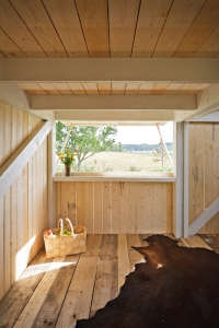 Anna and Eugeni Bach, Wood Playhouse with Finnish construction, interior open window hatch, Remodelista