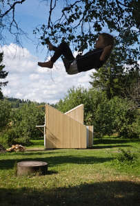 Anna and Eugeni Bach, Wood Playhouse with Finnish construction, girl on swing, Remodelista