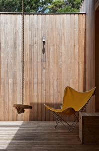 O'Connor-Houle-Melbourne-Mornington-Peak-wood-lined-master-outdoor-room-wood-swing-yellow-butterfly-chair