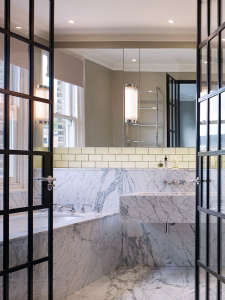 Stiff-and-Trevillion-remodel-West-London-Victorian-house-bathroom-Arabascato-marble-steel-framed-doors