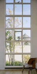 Messana-O'Rorke-Tank-House-New-York-water-tank-urban-tree-house-James-12-ft-high-window