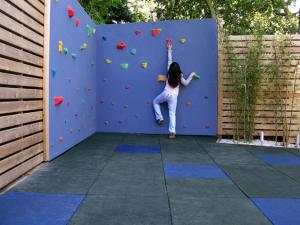 children-climbing-walls-in-garden-Shades-of-Green-Landscape-Architecture