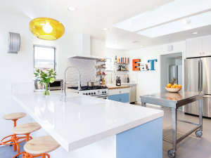 Remodelista-Reader-Rehab-Davis-Bungalow-reclaimed-orange-stools-kitchen-island