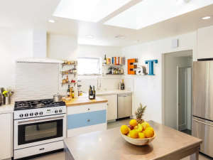 Remodelista-Reader-Rehab-Davis-Bungalow-Velux-skylight-light-blue-and-white-cabinets