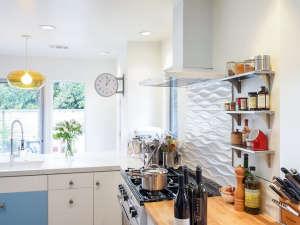 Remodelista-Reader-Rehab-Davis-Bungalow-aga-pendant-light-custom-cabinets-hood