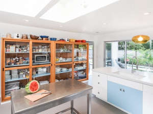 Remodelista-Reader-Rehab-Davis-Bungalow-reclaimed-shelving-kitchen-island-stainless-steel