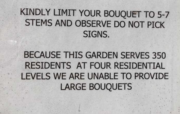 700_limit-bouquet-sign
