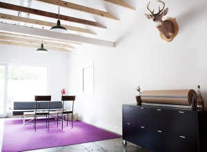 Fuzzco branding office with purple area rug