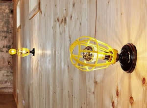Yellow industrial light cages as DIY lighting fixtures