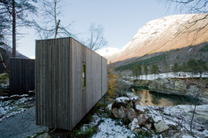 Modern minimalist wood architecture in hotel in Norway in winter forest