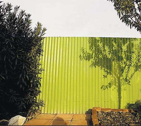 Outdoors Corrugated Metal Fence Painted Green Remodelista