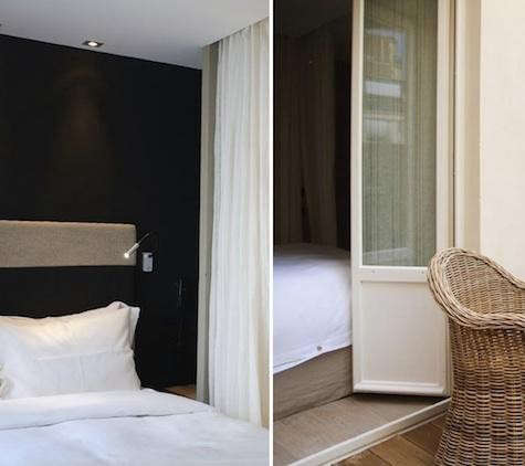hidden%20hotel%20black%20wall%20with%20wicker%20chair