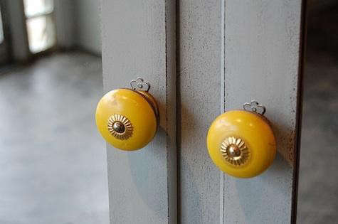 knack%20studios%20gray%20door%20yellow%20knobs