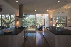 islands-in-the-main-part-of-the-house, Remodelista: Best Kitchen Space, for our austin lakehouse the kitchen flows freely in the main house space with two large islands. we have a subkitchen that houses an extra dishwasher, refrigerator, sink and other ap