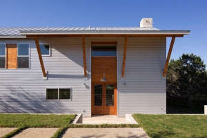 house-exterior-just-to-give-you-a-feel-for-the-who, Remodelista: Best Kitchen Space, for our austin lakehouse the kitchen flows freely in the main house space with two large islands. we have a subkitchen that houses an extra dishwasher, refrigerator, sink