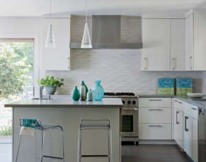 Tiburon-kitchen-remodel., Remodelista: Best Kitchen Space, A 60 year old ranch kitchen was transformed into open kitchen and eat-in space. The mid-century was channeled through Heath tile and 50's Chairs from Ebay which we remade.  The chandelier and art