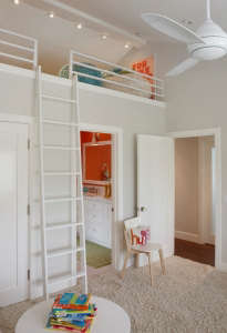 Access-ladder-to-the-loft-bed-above-the-bathroom, Remodelista: Best Bedroom Space, This creative solution for a girl's bedroom incorporated the space above the bathroom for the bed while leaving the rest of the room for child's play!