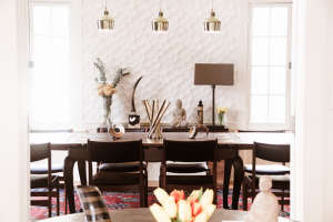 Audubon-Dining-Room.--Olivia-Erwin-Interiors, Remodelista: Best Kitchen Space, Mixing elements such as textured matte wall tiles from ModularArts & high gloss chocolate brown Farrow&Ball paint with an antique table, artifacts from Borneo, Aalto brass pend