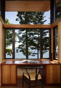 office-with-a-view!, Remodelista: Best Office Space, This small, compact office is really a glazed alcove, with the desk surface integrated seamlessly with wraparound windows and a sweeping view of the Hood Canal, a long, fjord-like arm of Puget Sound.The
